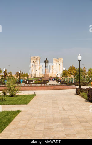 SHAKHRISABZ, UZBEKISTAN - OCTOBER 16, 2016: Historical park and monument to Amir Timur on the background and ruins of the Ak-Saray Palace. Workers in  - Stock Photo