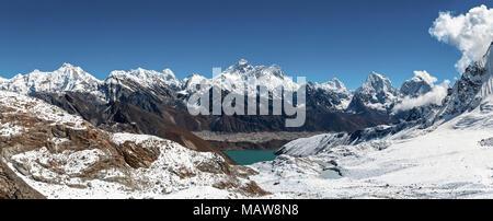 Everest, Lhotse, Makalu, Cholatse peaks and gokyo lake from Renjo pass - Stock Photo