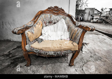 Tatty old chair in Indonesian kampung (Village) - Stock Photo