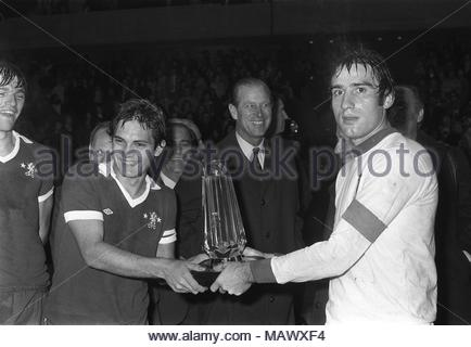 File photo dated 27-10-1975 of The Duke of Edinburgh presents The Prince Philip Cup to Chelsea captain Ray Wilkins, left, and Italian under 23's Captain Francesco Graziani at Stamford Bridge, London. - Stock Photo
