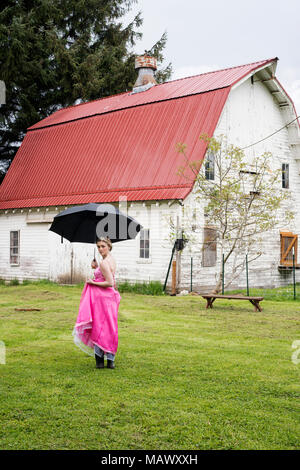 A young woman in her prom dress. - Stock Photo