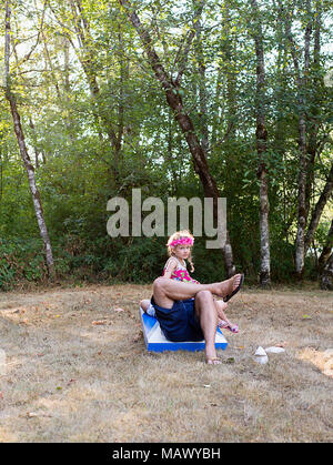 A young girl sitting on her dad. - Stock Photo