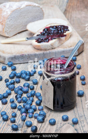 Homemade Blueberry jam and bread on a wood background - Stock Photo