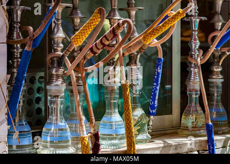 Shisha Water Pipes Lined up on the shelf at a cafe in Cairo, waiting for the customers - Stock Photo