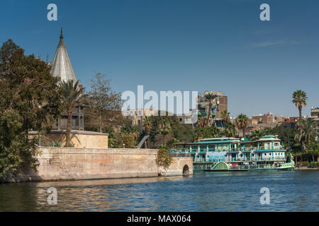 Cairo, Egypt February 11 2012: The Nileometer and tourist Sailing Boat on the River Nile in the middle of Cairo - Stock Photo