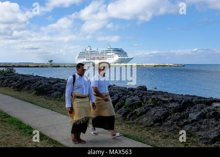 Local men walking at the waterfront in Nuku'alofa on Tongatapu island, Tonga. Nukuʻalofa is the capital of the Kingdom of Tonga - Stock Photo