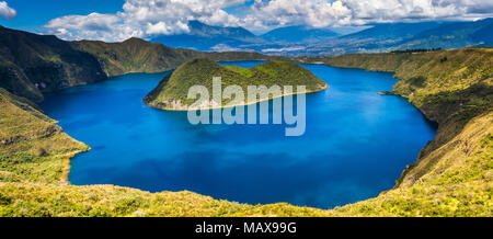Panoramic of Cuicocha, beautiful blue lagoon inside the crater of Cotacachi volcano - Stock Photo