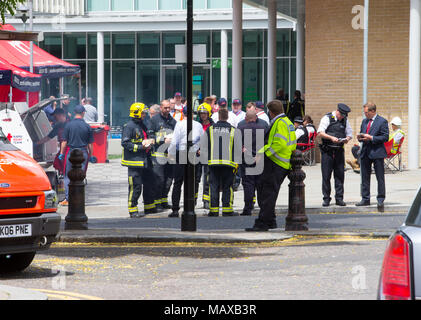 Firefighters and emergency services at the Grenfell Tower fire on 14 June 2017 in North Kensington, Royal Borough of Kensington and Chelsea. - Stock Photo