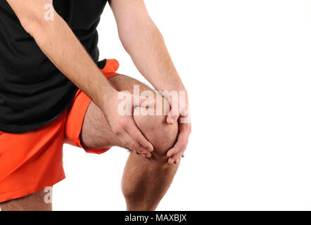 Man holds on to knee, pain in knee - Stock Photo