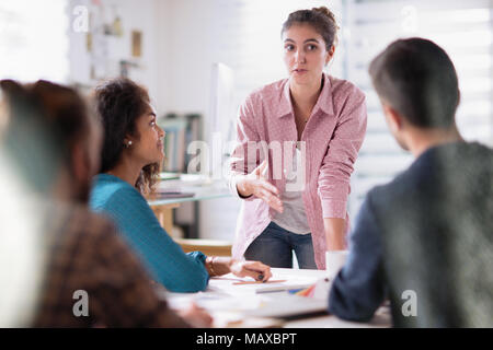 meeting office. young woman presents her project to her colleagues - Stock Photo