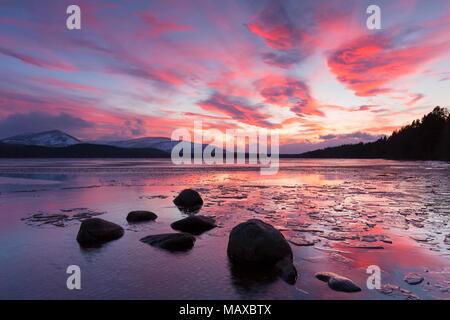 Loch Morlich at sunset in winter, Cairngorms National Park, Badenoch and Strathspey, Highland, Scotland, UK - Stock Photo