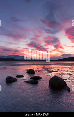 Loch Morlich at sunset in winter, Cairngorms National Park, Badenoch and Strathspey, Highland, Scotland, UK - Stock Photo