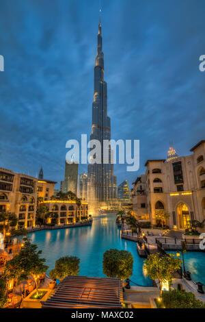 The Burj Khalifa illuminated at night in downtown Dubai, UAE, Middle East. - Stock Photo