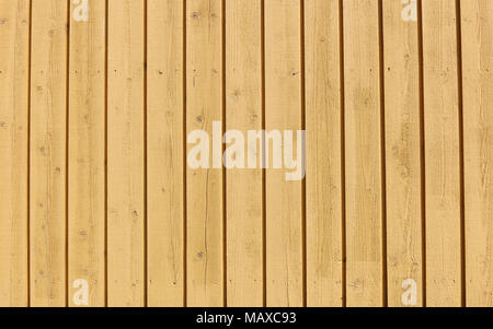 Yellow wooden wall with vertical lines. Beautiful clean symmetric surface texture. - Stock Photo