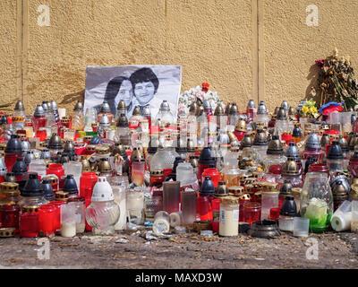 BRATISLAVA, SLOVAKIA-APRIL 2, 2018: Candles in memory of Slovak investigative journalist Jan Kuciak and fiancee Martina Kusnirova who were shot dead i - Stock Photo