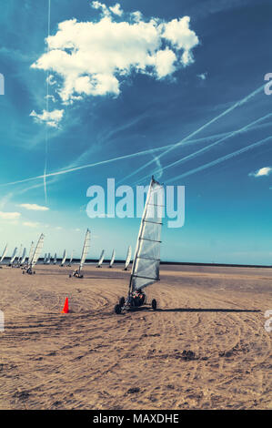 kite racing on the beach - Stock Photo