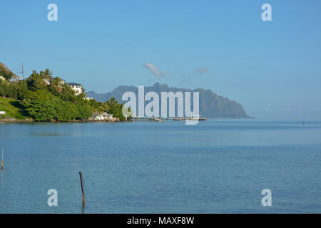 View of Kaneohe Bay with the mountains in the distance. Kaneohe Bay is located on the windward side of Oahu. - Stock Photo