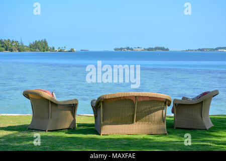 Lawn chairs in a Hawaiian waterfront backyard. This is on Oahu's Kaneohe Bay. - Stock Photo