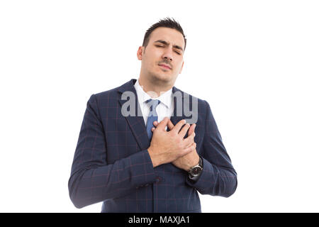 Businessman pressing chest expressing pain as hearth attack or failure concept isolated on white background - Stock Photo