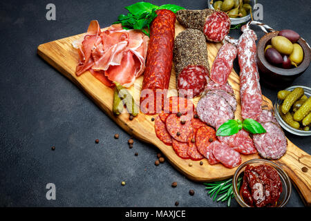 Set of traditional Italian meat snack. Salami, prosciutto, olives, capers - Stock Photo