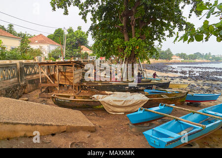 Sao Tome Fishermen preparing their nets and equipment at dawn ready for a days fishing out in the lagoon of this African Island. - Stock Photo