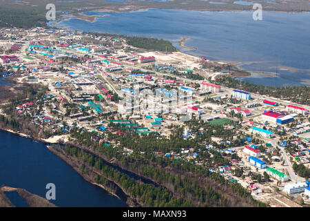 Aerial View of Novoagansk town, Tyumen region, Russia, which located on the bank of the Siberian river Agan in spring. Stock Photo