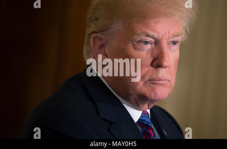 Washington, USA. 03rd Apr, 2018. United States President Donald J. Trump participates in a news briefing with presidents of Baltic countries at The White House in Washington, DC, April 3, 2018. - NO WIRE SERVICE - Credit: Chris Kleponis/Consolidated/dpa/Alamy Live News - Stock Photo