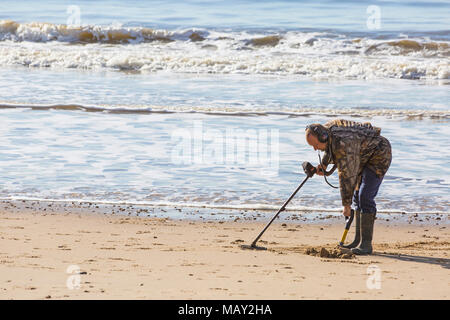 Bournemouth, Dorset, UK. 5th April 2018.  Treasure hunter looking for buried treasures on the beach on a warm sunny day. Credit: Carolyn Jenkins/Alamy Live News - Stock Photo