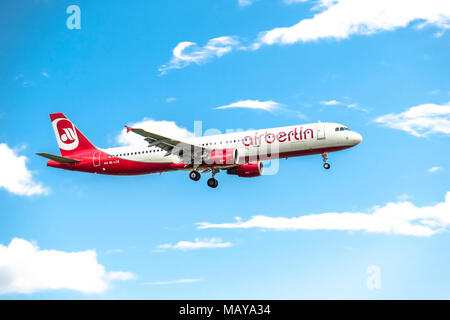 DUESSELDORF / GERMANY - OCTOBER 05 2017: Airberlin Niki Airbus A321 landing at Dusseldorf Airport - Stock Photo