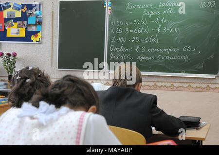 Gadjievo, Russia - September 16, 2010: Children in the class solve a mathematical problem - Stock Photo