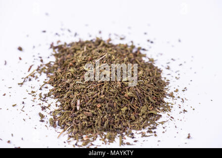 Mixed dried herbs on white background. - Stock Photo