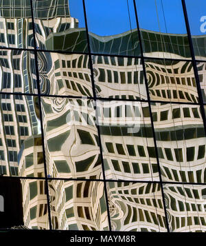 Different reflections in an office window in downtown Dallas, Texas, represents how there are different views, and the challenge for everyone to come together and agree on an action. - Stock Photo