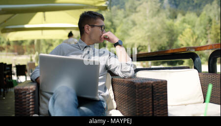 Bussiness man in caffe with bussines plan - Stock Photo