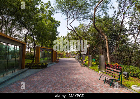 Guayaqil, Ecuador, December 20, 2016: Pedestrian walkway and park on the banks of Estero Salado in the city of Guayaquil - Stock Photo