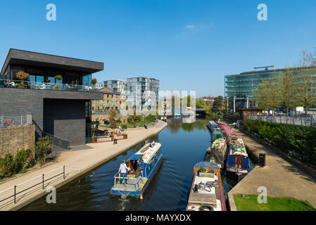 Narrowboat passing through the Regent's Canal area in King's Cross, London, UK - Stock Photo