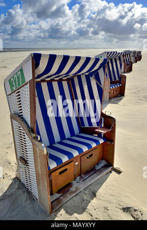 Blue-white beach chairs on the east beach White dune with blue clouds, Norderney, East Frisian Islands, North Sea, Lower Saxony - Stock Photo