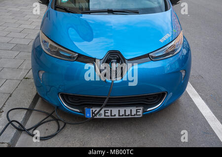 Electric car is charging charging cable, Munich, Bavaria, Germany - Stock Photo