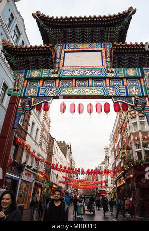London, United Kingdom – March 6 2018: People walking in the streets of the famous China town dressed with red balloons at the city of London in Unite - Stock Photo