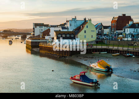 Boats on river Adur at sunset. - Stock Photo