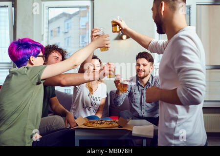 A group of friends is clinking glasses with beer. - Stock Photo
