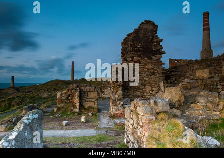 The disused tin mine seems and engine houses at levant tin mine botallack near pendeen and trewellard in west cornwall on the side of the cliffs coast - Stock Photo