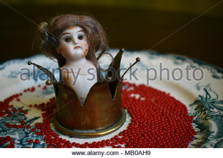 Antique porcelain doll princess with a crown. - Stock Photo