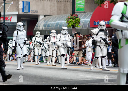 Atlanta, GA, USA - August 31, 2013:  A group of Star Wars storm troopers walks by spectators at the annual Dragon Con parade on Peachtree Street. - Stock Photo