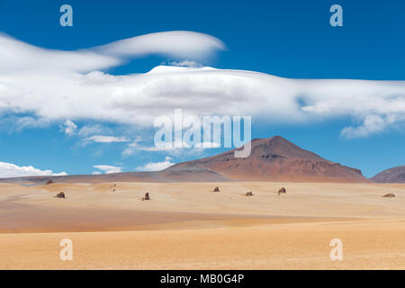 The Dali Desert near the Uyuni Salt Flat (Salar de Uyuni) with rock formations and clouds that could have been drawn by the master himself, Bolivia. - Stock Photo