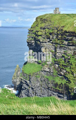 Highest point of the Cliffs of Moher with O'Brien's Tower landmark on west coast of Ireland. - Stock Photo