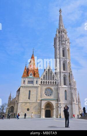 Budapest, Hungary - March 27, 2018: Matthias Church is a Roman Catholic church located in Budapest, Hungary, in front of the Fisherman's Bastion at th - Stock Photo