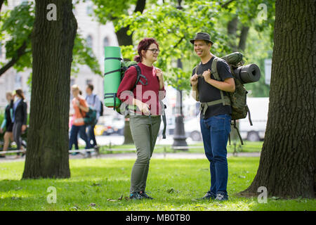 Two young tourists backpackers having fun in the park - Stock Photo