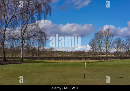 The Green and Pin Marker at Hole 1 of the Glens Course at Letham Grange Golf Club in Colliston, Arbroath, Scotland. - Stock Photo