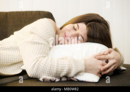 Repentigny,Canada,27,March,2018.Young woman taking a nap on couch.Credit:Mario Beauregard/Alamy Live News - Stock Photo