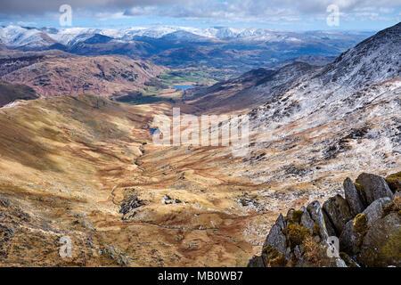 Cumbria / UK - April 5th 2018: The English Lake District and the Tilberthwaite fells with Little Langdale in the distance - Stock Photo